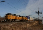 UP 2356 flies through this small town with an SP trackage rights train at CA Junction.