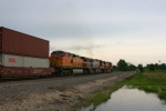 BNSF 5431 leads a stacktrain towards the town of Bucklin as it starts to rain. Again...