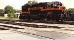 GP38-2 # 3802, built as Altos Hornos Steel # 141 leads a train through the interlocking