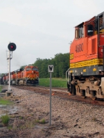 An EB sits dead in the siding as a WB passes