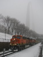 A BNSF coal train passes beneath the Gateway Arch