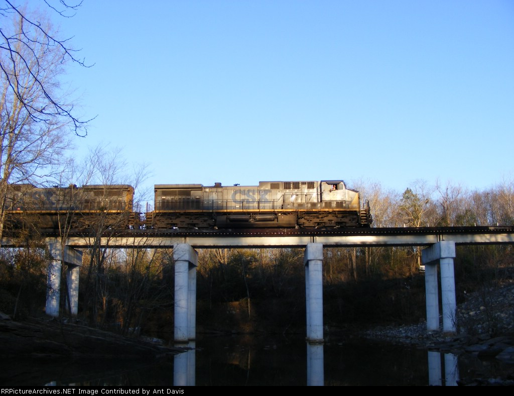 The Engineer gives a very friendly wave as CSX 82 passes late in the evening