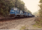 Eastbound coal train with C40-8w 6093 leads three EMD's