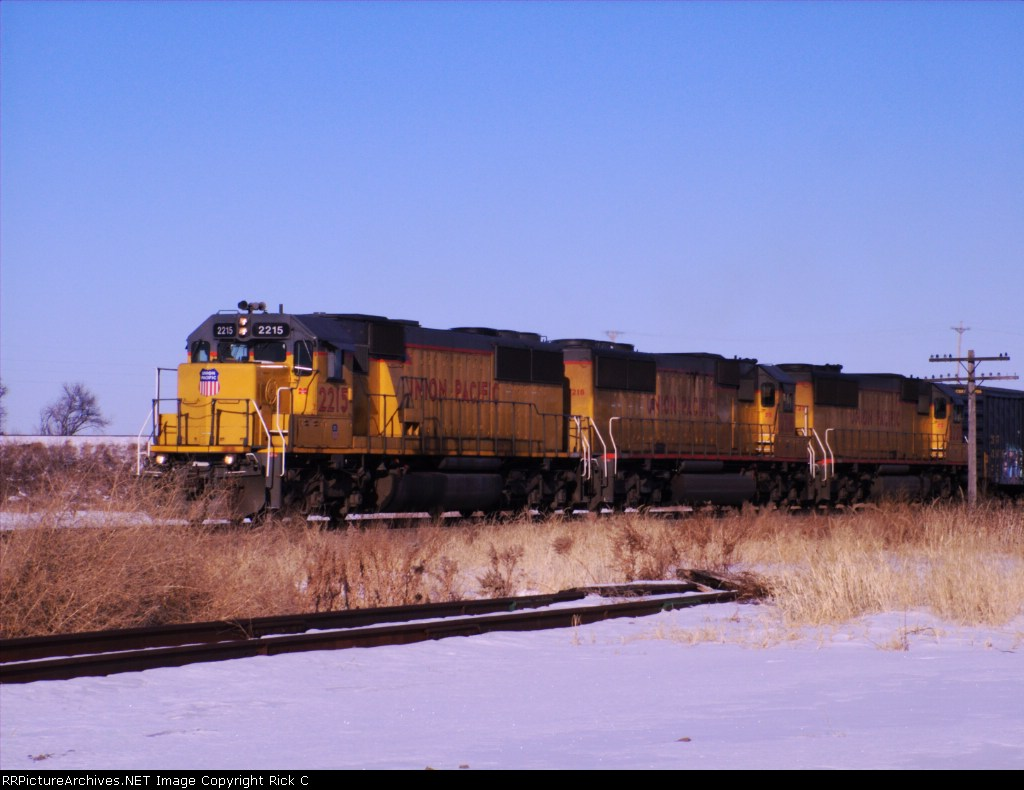 UP 2215 Leads A High HP Standard Cabbed Consist SB