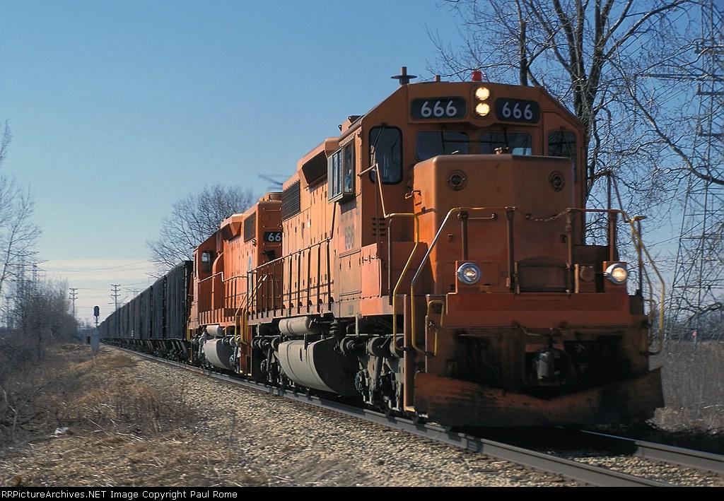 EJ&E 666 leads a northbound empty coal train