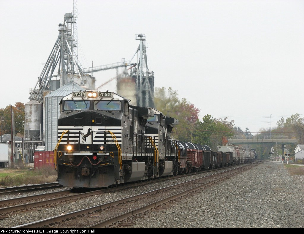 NS 9946 & 9865 roll east through town with 14Q