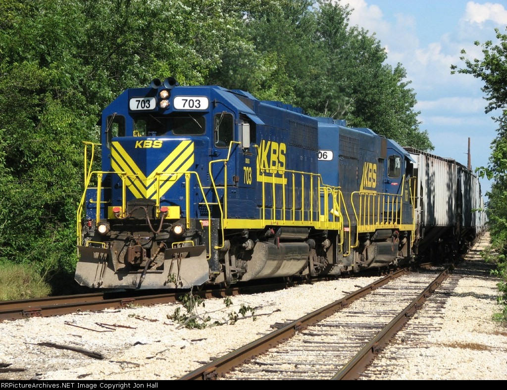 703 leads its train through the switch back towards Iroquois Junction