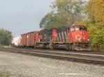 CN 5354 & 5789 head east with 17R and traffic off the WC