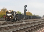 NS 5528 comes out of the yard with a cut of open hoppers