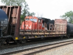With M396 heading east, CN 5792 rolls by with M395