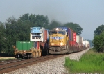 25A rolls past another intermodal sitting in the siding