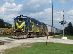 703 & 706 hustle through town with a grain train