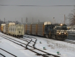 21T tears west down the main as it passes the CSX yard