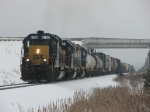 CSX 8189, with the assistance of two GP38-2's, slowly roll west with Q335-04