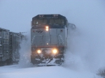 AMTK 517 bursting through the fresh snow with P371