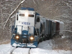 24 starts to pull its train eastward out of the tunnel of snow outlined trees
