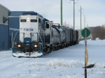 24 leads its train through the snow covered yard