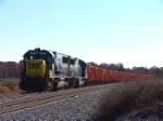 CSX 2493 leads a repainted string of solar powered ballast cars
