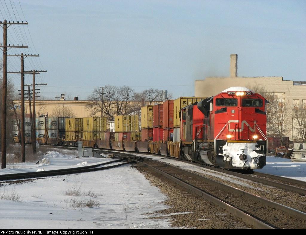 CN 8002 & 2435 head east again with Q148