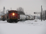 CN 9574 leading M391 out of the yard with its pick up