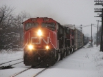 CN 5682 leading 4 other units with a westbound