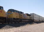 UP 8501 #3 power in an EB doublestack past the detector at MP960.3 at 12:11pm