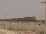 UP 4989 leads a WB doublestack (in a dust storm) at 12:48pm