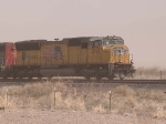 UP 4898 leads a WB doublestack (in a dust storm) at 12:48pm