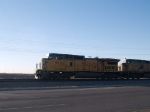 UP 9502 leads an EB doublestack at 7:57am