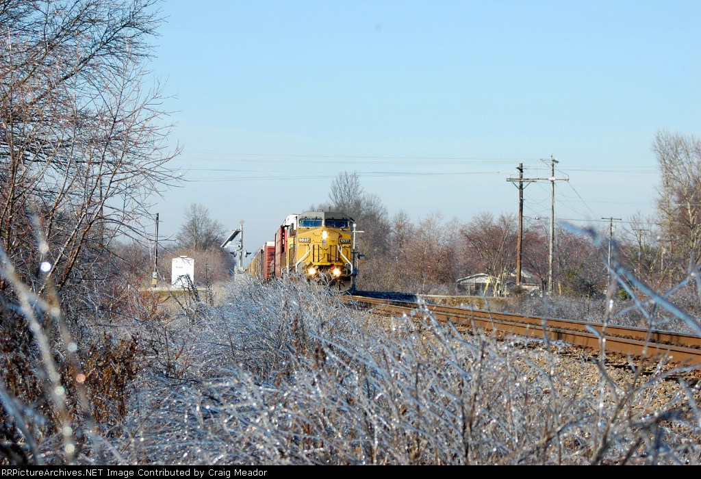 UP 9537 leads a train north with a winter glaze on the ground.