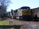 CSX 682 passes a loaded coal train