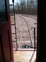 looking out of the caboose's back door