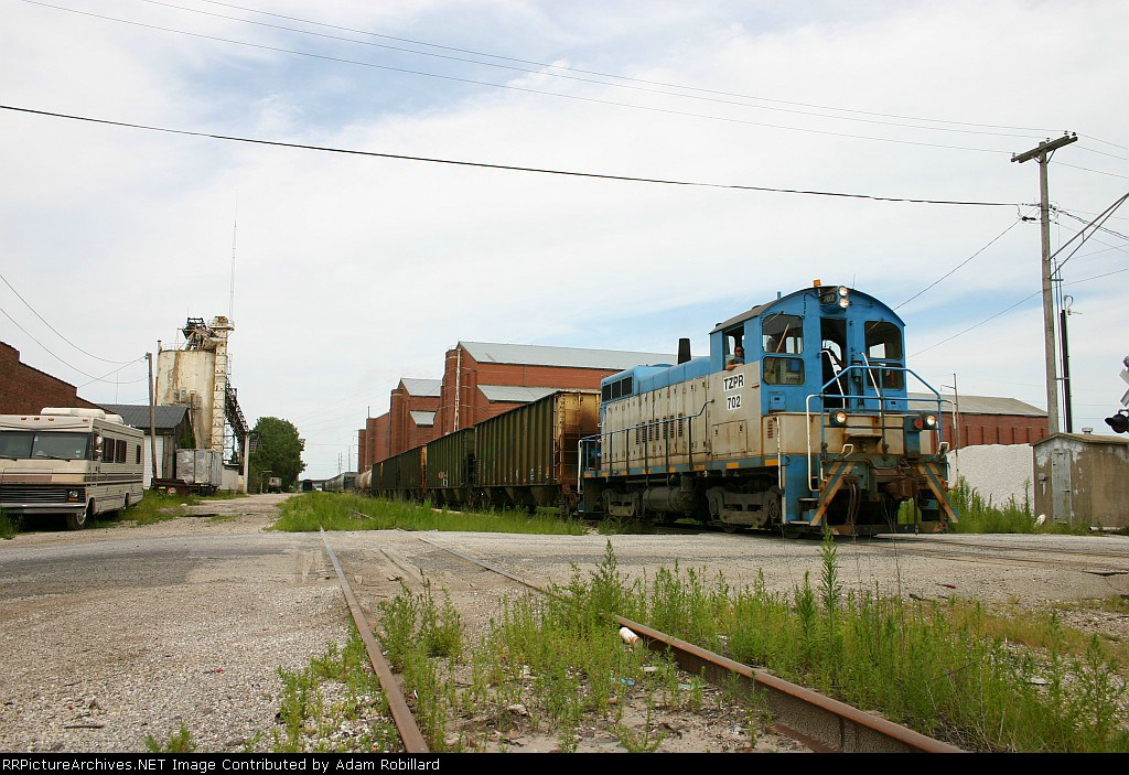 TZPR 702 heads south through the industrial side of town