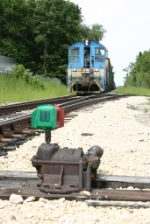 TZPR 702 rolls past a now dormant industry track