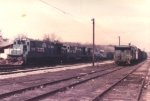 Youngwood Yard in 1982 with GE B23-7's on an empty hopper train.