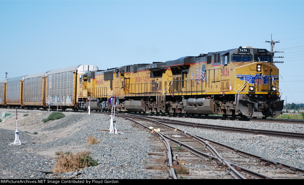 UP 5436 leads a mixed train of autoracks and double stacks