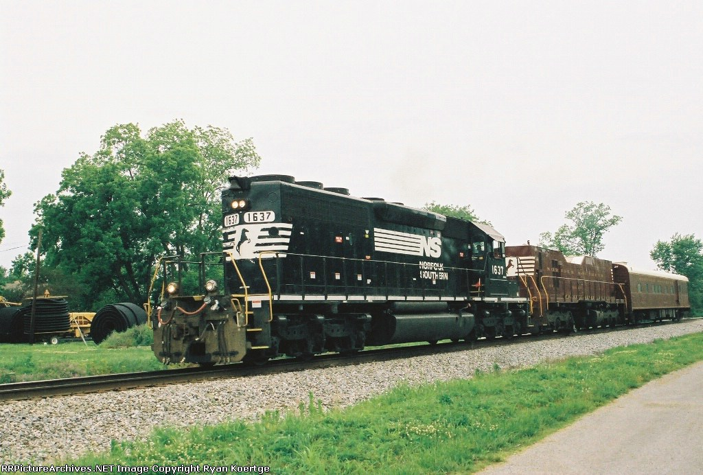 NS 1637 running long hood forward with track inspection cars.