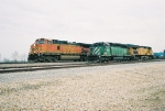 WB BNSF 5222 passes by FURX, UP grain train