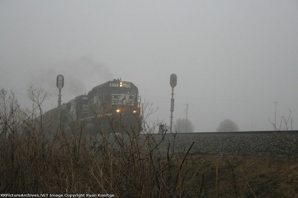 WB Norfolk Southern local at Albion, Il. on a foggy morning.