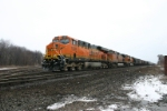 BNSF 7569 is west with grain loads