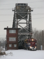 3865 leads the 800 Job off the Saginaw River bridge