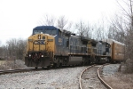CSX 9033, 7661 passes by E. Harwood in Evansville, In..