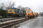 SB CSX 7706 passes by MOW equipment