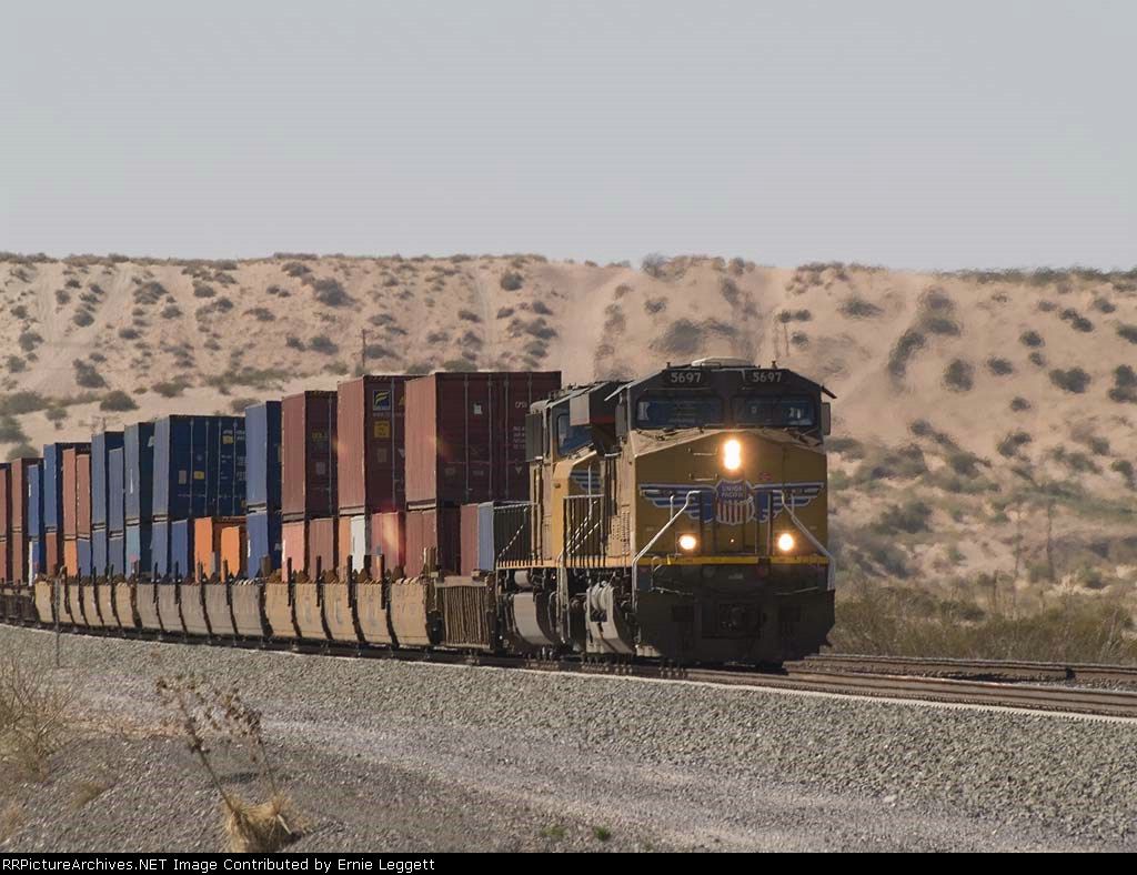 UP 5697 leads an EB doublestack at 3:25pm