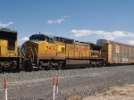 UP 9413 #2 power in a WB autorack at 12:19pm