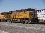 UP 5552 leads an EB autorack past a WB manifest at 2:56pm
