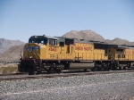 UP 4642 leads a WB doublestack at 12:47pm