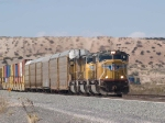 UP 4463 leads an EB autorack/doublestack at 12:50pm