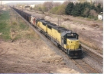 A pair of SD50s get help from a SOO dash 2