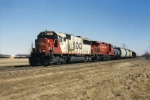 Classy SD60 leads a mix freight West